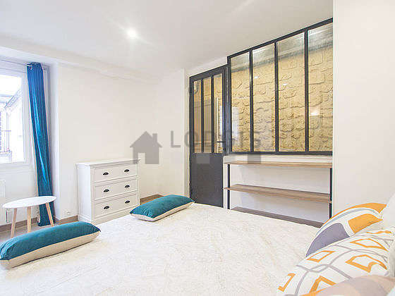Bright bedroom equipped with storage space