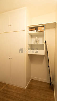 Beautiful dressing-room serviced with : wardrobe, shelves