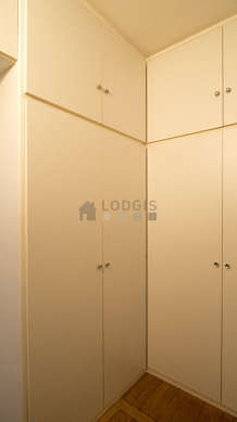 Very quiet walk-in closet with wooden floor