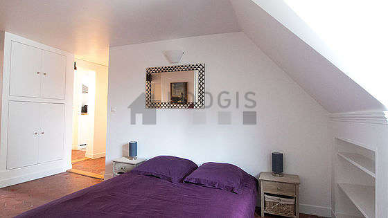 Very quiet living room furnished with 1 bed(s) of 140cm, tv, closet, 4 chair(s)