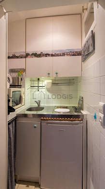Kitchen of 1m² with tile floor