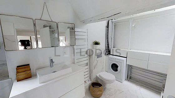 Bathroom equipped with bath tub, hair-dryer
