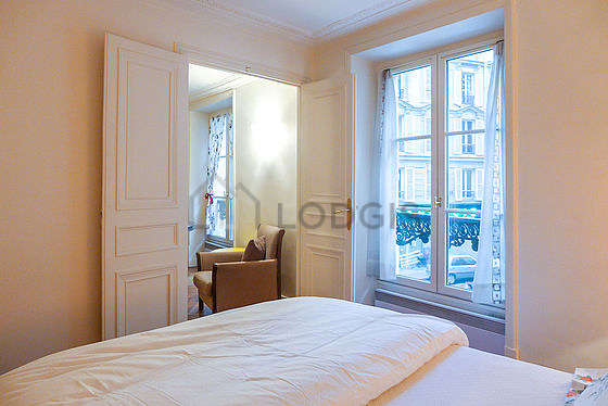 Very bright bedroom equipped with sofa
