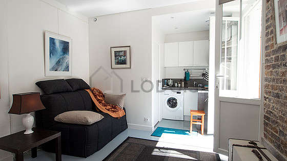 Quiet living room furnished with sofa, closet, 4 chair(s)