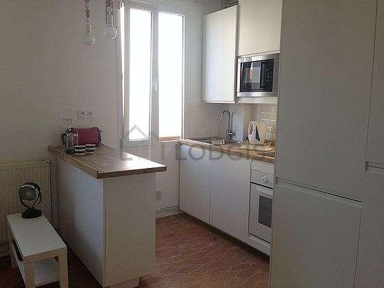 Beautiful kitchen of 6m² with paving floor