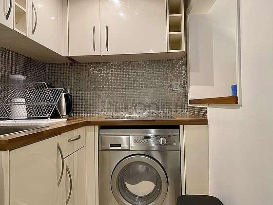 Kitchen equipped with washing machine, refrigerator, crockery