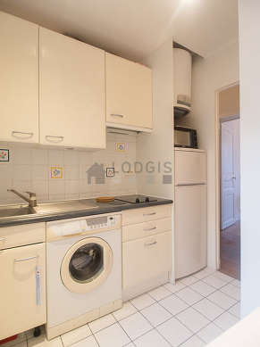 Kitchen where you can have dinner for 3 person(s) equipped with washing machine, refrigerator, extractor hood, crockery