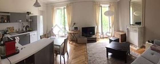 Quiet living room furnished with tv, cupboard, 1 chair(s)