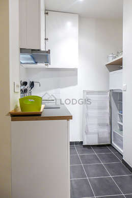 Kitchen equipped with refrigerator, freezer, crockery