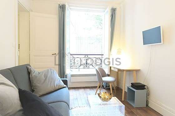 Very quiet living room furnished with 1 sofabed(s) of 140cm, tv, wardrobe, 1 chair(s)