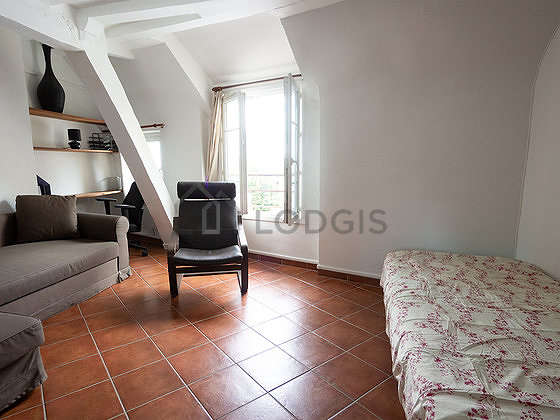 Living room with tile floor