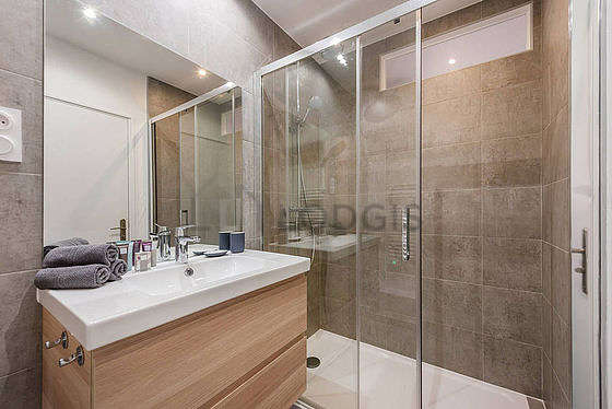 Pleasant and bright bathroom with tile floor