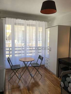 Quiet living room furnished with dining table, closet, storage space, 2 chair(s)