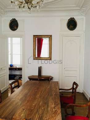 Dining room with wooden floor for 8 person(s)