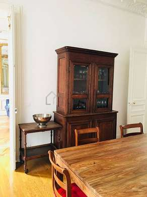 Dining room of 18m² equipped with dining table, closet