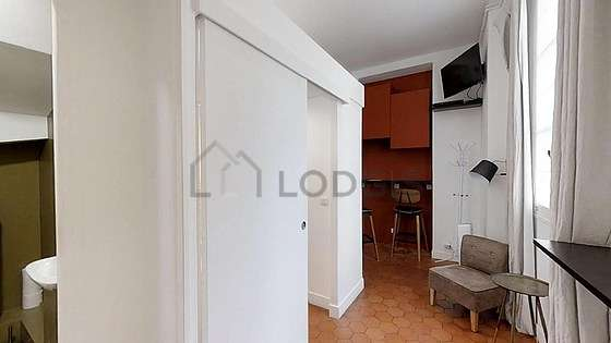 Very quiet living room furnished with tv, fan, 2 armchair(s)