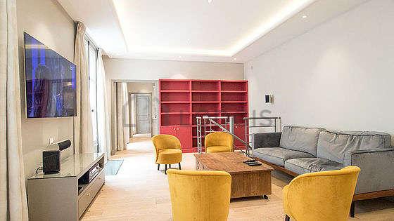 Living room furnished with home cinema, tv, hi-fi stereo, wardrobe