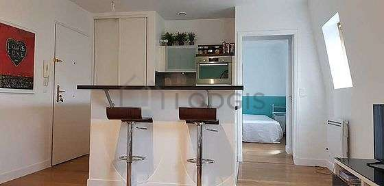 Kitchen where you can have dinner for 2 person(s) equipped with oven, dining table, stool