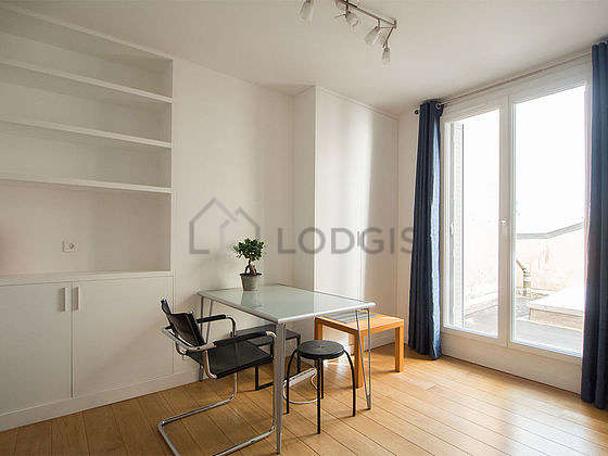 Very quiet living room furnished with 1 bed(s) of 140cm, dining table, coffee table, wardrobe