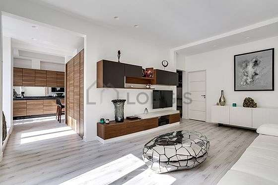 Very quiet living room furnished with tv, cupboard