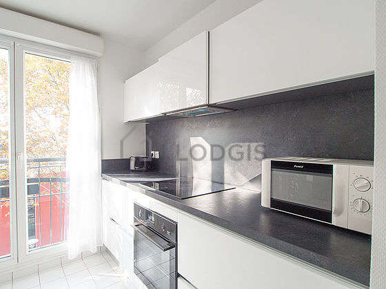 Kitchen equipped with dishwasher, oven, extractor hood, crockery