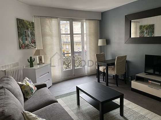 Very quiet living room furnished with 1 sofabed(s) of 160cm, dining table, storage space, 2 chair(s)