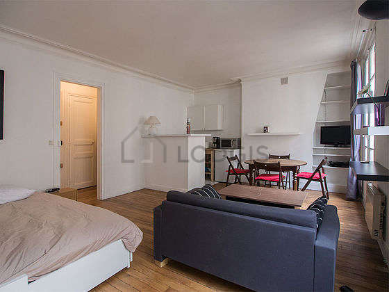 Bright living room furnished with wardrobe, 4 chair(s)