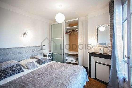 Bedroom with wooden floor