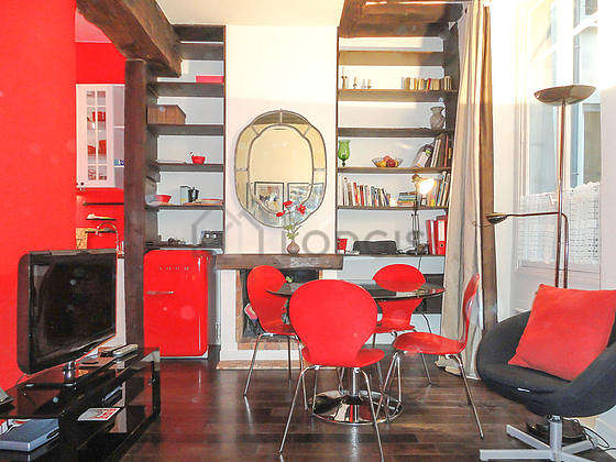Living room furnished with tv, storage space, 1 chair(s)