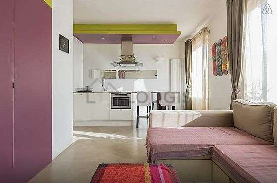Quiet living room furnished with tv, storage space, cupboard