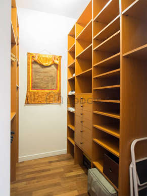 Walk-in closet with wooden floor