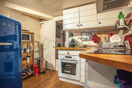 Kitchen equipped with dishwasher, refrigerator, crockery