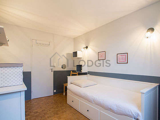 Very bright bedroom equipped with storage space