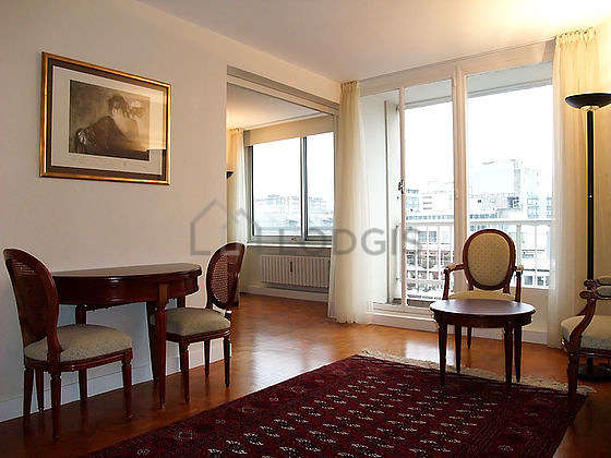 Very quiet living room furnished with tv, storage space, 4 chair(s)