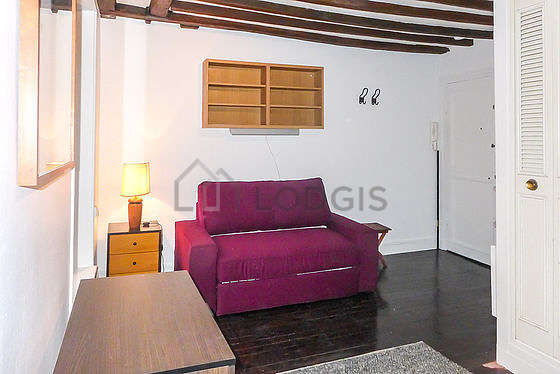 Quiet living room furnished with 1 sofabed(s) of 140cm, tv, storage space, cupboard