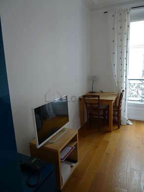Bright bedroom equipped with tv, sofa, 1 armchair(s), 2 chair(s)