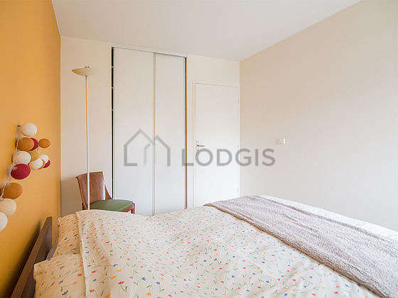 Bright bedroom equipped with storage space, cupboard