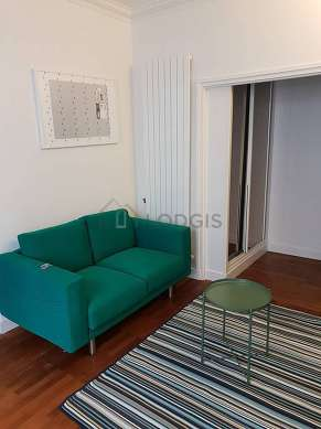 Quiet living room furnished with sofa, wardrobe, cupboard, 1 chair(s)