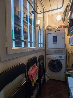 Beautiful laundry room with tile floor and equipped with washing machine, dryer, 1 chair(s)
