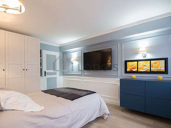 Bright bedroom equipped with tv