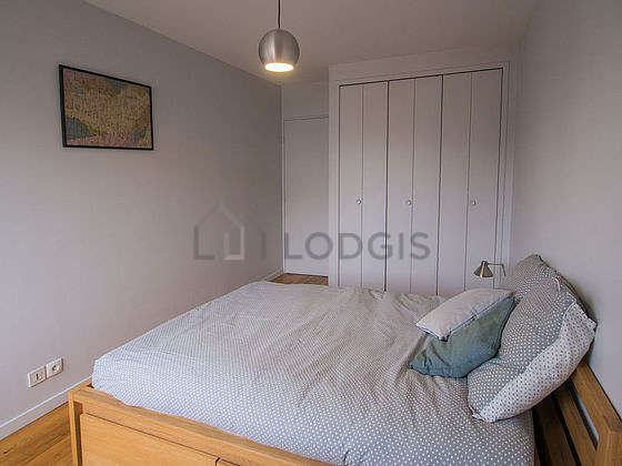 Very bright bedroom equipped with wardrobe, bedside table