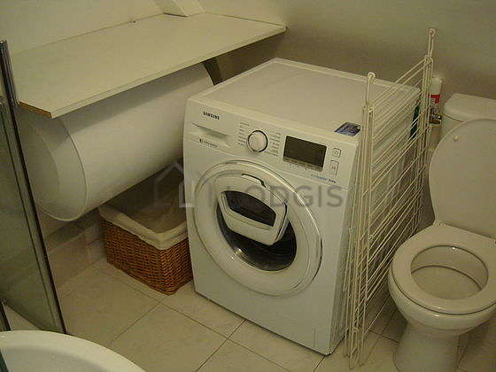 Bathroom equipped with washing machine, bath towels