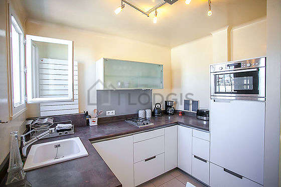 Kitchen where you can have dinner for 2 person(s) equipped with dishwasher, refrigerator, freezer, crockery