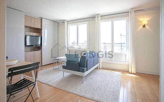 Very quiet living room furnished with 1 murphy bed(s) of 140cm, tv, storage space, 1 chair(s)