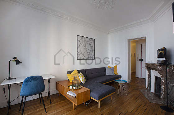 Very quiet living room furnished with tv, storage space