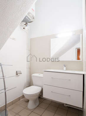 Bathroom equipped with dryer, cupboard