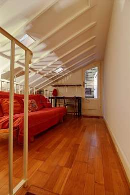 Mezzanine with a high ceiling with wooden floor