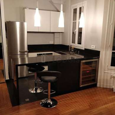 Kitchen where you can have dinner for 2 person(s) equipped with hob, refrigerator, crockery