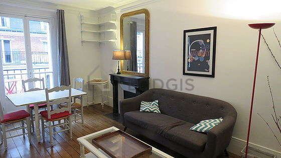 Very quiet living room furnished with sofa, coffee table, storage space, 4 chair(s)