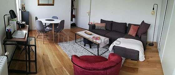 Very quiet living room furnished with tv, fan, 1 armchair(s), 1 chair(s)